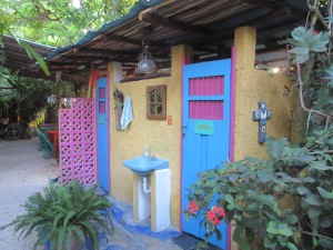Colourfully painted outdoor washrooms and showers