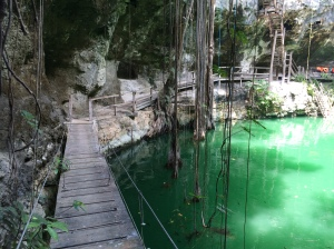 The suspension bridge and wooden boardwalk around the interior of the cenote