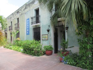 The front of Hostel La Candelaria from the plaza/square