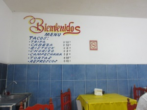 Menus are usually painted directly on the wall in Spanish or written on poster board